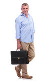 Casual middle aged man carries briefcase Stock Photo