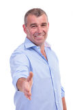 Casual middle aged man giving handshake Stock Photo