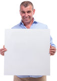 Casual middle aged man holding banner Stock Photo