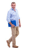 Casual middle aged man holding his clipboard Royalty Free Stock Photos