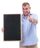 Casual middle aged man holds blackboard Royalty Free Stock Photo