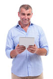 Casual middle aged man holds tablet Stock Photography