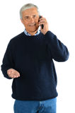 Casual Middle Aged Man in Jeans with Cell Phone Royalty Free Stock Images