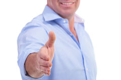 Casual middle aged man offering handshake Stock Photo