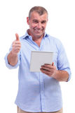Casual middle aged man with pad and ok sign Stock Photos