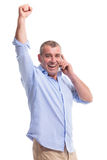 Casual middle aged man on phone and cheering Stock Image