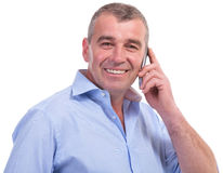 Casual middle aged man on the phone Stock Images