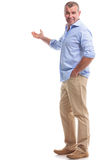 Casual middle aged man presents in the back Royalty Free Stock Photos
