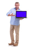 Casual middle aged man presents his laptop Royalty Free Stock Photography