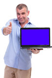 Casual middle aged man recommends laptop Stock Images