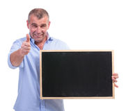 Casual middle aged man showing blackboard Stock Photos