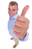 Casual middle aged man showing thumb up Stock Photo