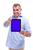 Casual middle aged man shows his tablet Royalty Free Stock Photos