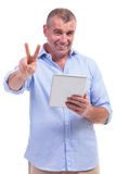 Casual middle aged man shows victory sign Stock Photography