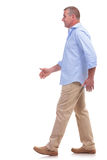 Casual middle aged man strolling Royalty Free Stock Photo