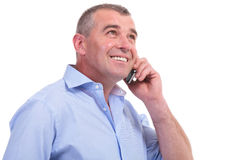 Casual middle aged man talks on phone Royalty Free Stock Photo