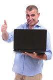 Casual middle aged man thumb up with laptop Royalty Free Stock Photos