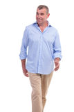 Casual middle aged man walking Royalty Free Stock Image