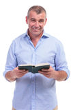 Casual Middle Aged Man With His Book Stock Photography
