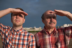 Casual middle aged men looking far away Stock Photos
