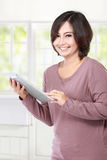 Casual middle aged  Woman holding tablet computer Stock Image