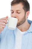 Casual model drinking a coffee Royalty Free Stock Photos