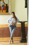 Casual modern girl in ancient palace Royalty Free Stock Images