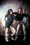 Casual. Modern hip-hop dancers over grunge background. Urban, disco style Royalty Free Stock Photography