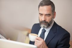 Casual morning coffee for a senior business man Stock Images