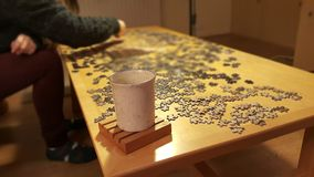 Casual night with tea and puzzle pieces Royalty Free Stock Photography