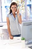 Casual office worker on phone smiling Stock Photography