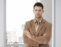Casual office worker standing arms crossed Royalty Free Stock Images