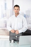 Casual office worker standing in office Royalty Free Stock Image