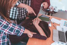 Casual office workers blaming on upset team mate Royalty Free Stock Photo