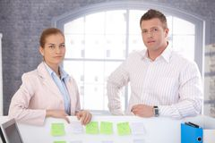 Casual office workers standing in office Royalty Free Stock Photos