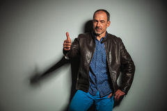 Casual old man in leather jacket making the ok sign Stock Photography