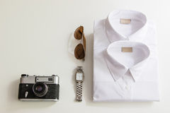 Casual outfits with accessories on white background. Casual outfits with clothing and accessories on white background Stock Photo