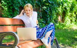 Casual and part time outdoor jobs. Workplace outdoors. Working outdoors. Freelance lifestyle advantages. Girl sit bench. With notebook. Woman with laptop works royalty free stock images