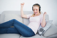Casual partying blonde listening to music Royalty Free Stock Photography