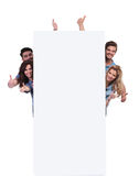 Casual people behind a big banner making the ok  sign Stock Photography