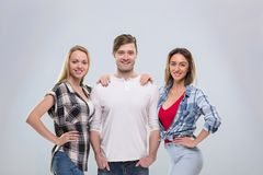 Casual People Group, Young Man Two Woman Happy Smile Handsome Guy Beautiful Girls Royalty Free Stock Image
