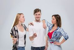 Casual People Group, Young Man Two Woman Happy Smile Handsome Guy Beautiful Girls Point Finger To You Talking Royalty Free Stock Photography