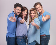 Casual people making the ok thumbs up hand sign Royalty Free Stock Photography