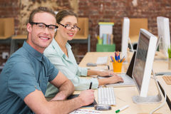 Casual photo editors at work in office Royalty Free Stock Images