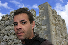 Casual portrait. Portrait close up of a man with a castle on the background Stock Photography