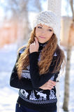 Casual portrait of a beautiful happy smiling girl in winter park Royalty Free Stock Photography