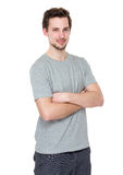Casual portrait of happy university student guy standing with ar. Ms folded isolated on white background Royalty Free Stock Photos