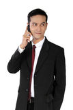 Casual pose of businessman on phone, isolated on white Stock Photos