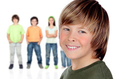 Casual preteen boy and unfocused casual children Royalty Free Stock Photography
