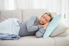 Casual pretty blonde lying on couch sleeping Royalty Free Stock Images